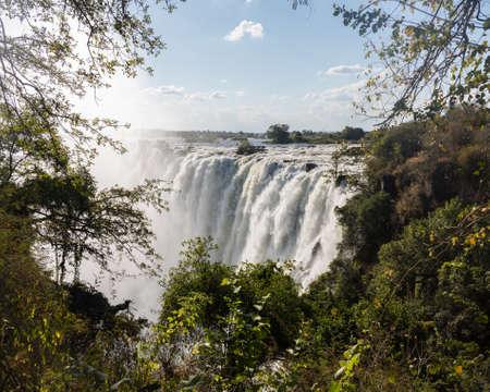 zambian: Victoria Falls (or Mosi-oa-Tunya - the Smoke that Thunders) waterfall in southern Africa on the Zambezi River at the border of Zambia and Zimbabwe. Image taken from Zambian side of falls
