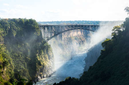 Victoria Falls (or Mosi-oa-Tunya - the Smoke that Thunders) waterfall in southern Africa on the Zambezi River at the border of Zambia and Zimbabwe. Image taken from Zambian side of falls