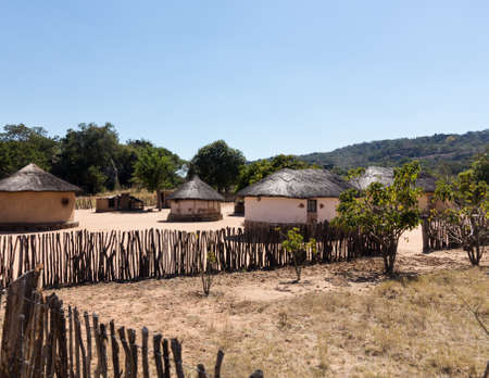 View of thatched mud homes in typical african village in Zimbabwe