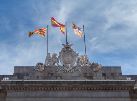 Flags flying on top of the Town Hall or Casa de la Ciutat in Barcelona Spain