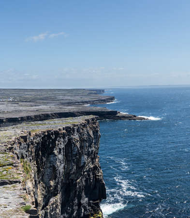 dun: Dun Aonghasa or Dun Aengus is the most famous of several prehistoric forts on the Aran Islands of County Galway, Ireland. It is on Inishmore, at the edge of an 100 metre high cliff