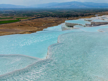 thermal spring: Hot springs create cascades and travertines of calcium running down hillside in Pamukkale in Turkey Stock Photo