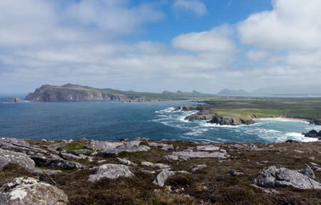 headland: View along the coastline to Sybil Head on the western point of County Kerry near Dingle in Ireland or Eire. This headland is shaped like the Sydney Opera House