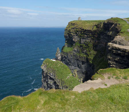 headland: Castle on headland at Cliffs of Moher in South Western Ireland in Burren Region of County Clare