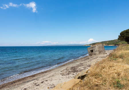 allied: Old concrete bunker or pillbox on the beach at Anzac Cove in Gallipoli where allied troops fought in World War 1 Stock Photo