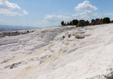 Hot springs create cascades and travertines of calcium running down hillside in Pamukkale in Turkey Stok Fotoğraf