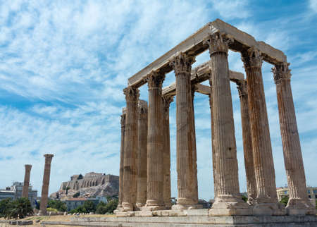 olympian: The Temple of Olympian Zeus also known as the Olympieion or Columns of the Olympian Zeus, is a colossal ruined temple in the centre of the Greek capital Athens that was dedicated to Zeus, king of the Olympian gods. Stock Photo