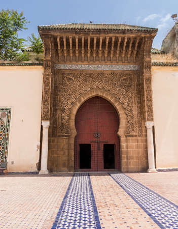 large doors: Large wooden doors in archway  as entrance to Dar El Makhzen palace, located in El Mechouar Stinia. It was Moulay Ismaïl official palace