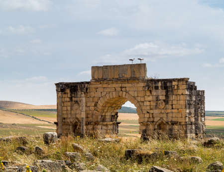 3rd century: Volubilis is a partly excavated Roman city in Morocco situated near Meknes between Fes and Rabat. Built in a fertile agricultural area, it was developed from the 3rd century BC onwards as a Phoenician Carthaginian settlement Stock Photo