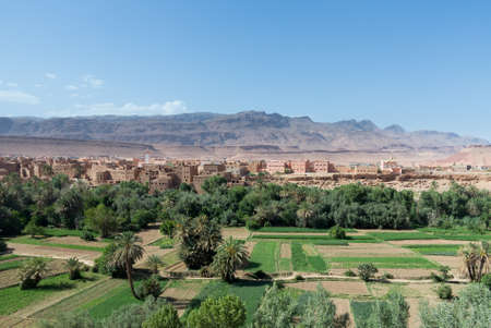 Tinghir in Morocco is a town set in the dry desert in the midst of a green oasis like river photo