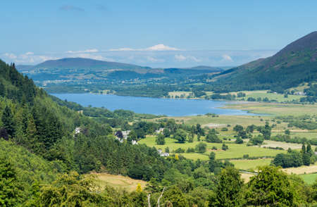 countryside landscape: Lake District hills surrounding Bassenthwaite Lake framed by the trees on the lakeside. Idyllic image from the English Lakes