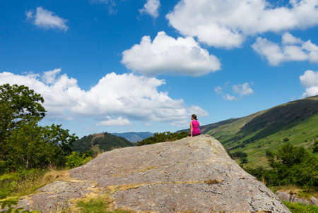 cumbria: Female young hiker overlooking Thirlmere in English Lake District in Lakeland Cumbria