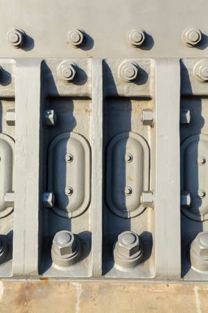 steel head: Close up details of the very large painted nuts and bolts in the support structure of the Sydney harbour bridge in Australia