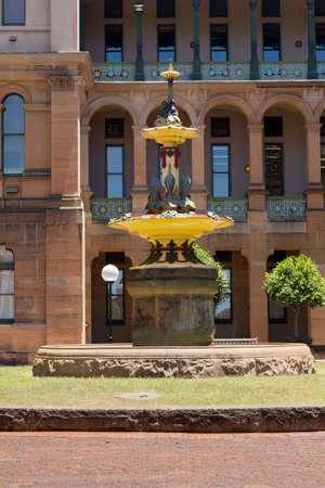 surmounted: Fountain dedicated to Robert Brough installed in 1907 by Nightingale Wing of Sydney Hospital. Created in the Colebrookdale factory in UK and installed near the Nightingale Wing in 1907. The design comprises a group of brolgas surmounted by black swans dis