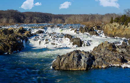 Great Falls on Potomac river outside Washington DC in winter with ice forming on the cascades and snow on the rocks photo