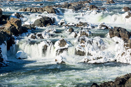 Great Falls on Potomac river outside Washington DC in winter with ice forming on the cascades and snow on the rocks Stock Photo