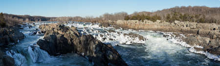 rushing water: Panorama of Great Falls on Potomac river outside Washington DC in winter with ice forming on the cascades and snow on the rocks