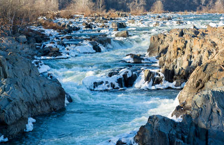 whitewater: Great Falls on Potomac river outside Washington DC in winter with ice forming on the cascades and snow on the rocks Stock Photo