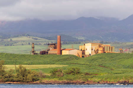 abandoned factory: Old sugar mill or factory now abandoned on the coast of Kauai in Hawaii