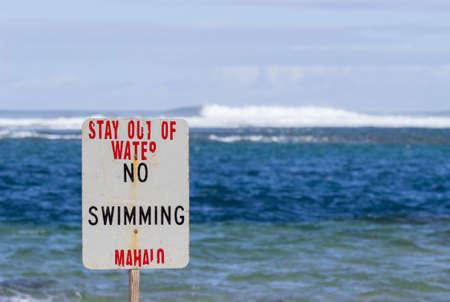 no swimming sign: Warning sign no swimming in treacherous winter waters on Tunnels Beach in Kauai Hawaii