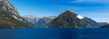 fiordland: Panorama of Doubtful Sound on South Island of New Zealand aboard a cruise ship showing strong headwinds coming towards the ship Stock Photo