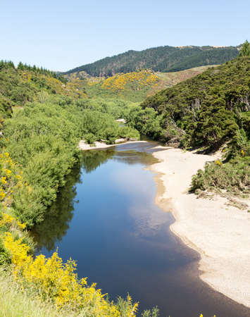 Railway track of Taieri Gorge tourist railway runs alongside river in a ravine on its journey up the valley Reklamní fotografie