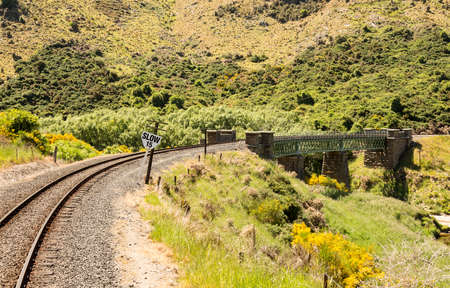 narrow gauge railways: Railway track of Taieri Gorge tourist railway crosses a bridge across a ravine on its journey up the valley