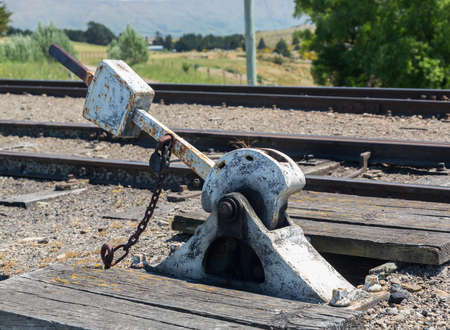 Heavy duty points lever by railway track of Taieri Gorge tourist railway Stock Photo