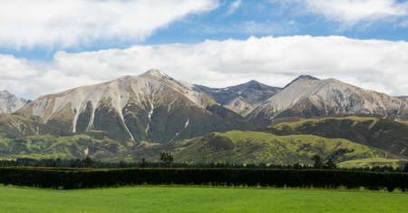 lowlands: View from the train windows of TranzAlpine railway that climbs the Southern Alps in New Zealand towards Arthurs Pass