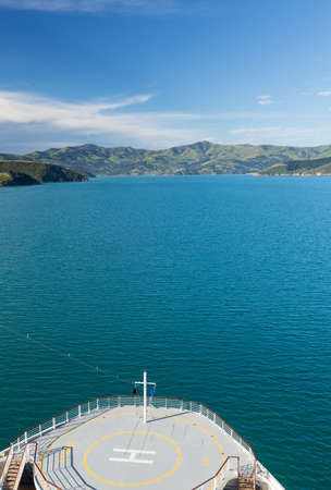 ship bow: Cruise ship bow approaching the coastline around Akaroa harbour near Christchurch on South Island of New Zealand Stock Photo