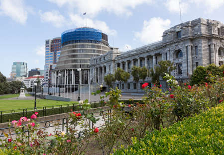 New Zealand Parliament government building known as Beehive in Wellington with Parliament House in foreground