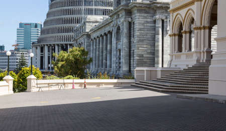 Parliamentary Library building in Wellington New Zealand with Parliament House and Beehive in background