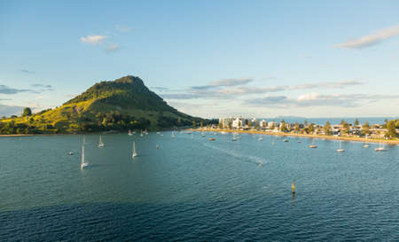 The bay and harbour at Tauranga with calm water in front of the Mount