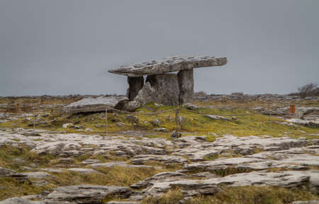 eire: Poulnabrone Dolmen burial chamber near Burren in Eire on a grey cloudy day