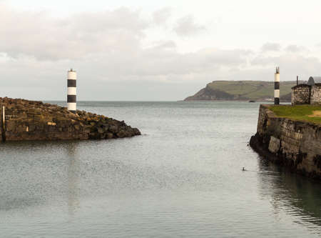 northern ireland: Entrance from the shelter behind the solid sea wall at Carnlough Harbor in Northern Ireland