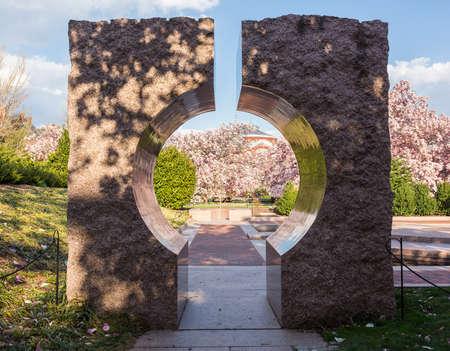 entranceway: Entrance to Enid A Haupt garden through large granite Moon Gate entranceway in Washington DC Stock Photo