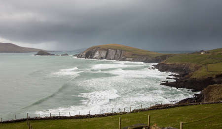 eire: View along the coastline to Sybil Head on the western point of County Kerry near Dingle in Ireland or Eire.
