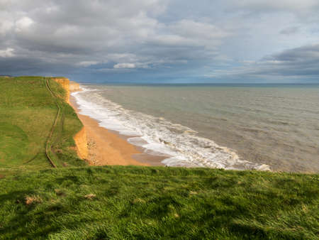 headland: Cliff top path along the headland on Jurassic Coast cliffs  at West Bay in Dorset. This was used as the location for the Broadchurch TV series