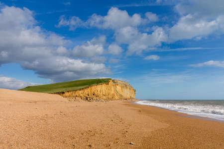 Wide beach underneath Jurassic Coast cliffs and headland at West Bay in Dorset used as the location for the Broadchurch TV series Stok Fotoğraf