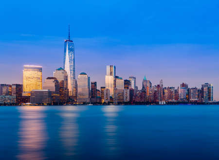 Skyline of lower Manhattan of New York City from Exchange Place at night with World Trade Center at full height of 1776 feet