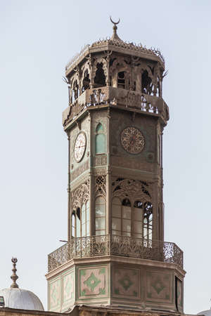 clocktower: Antique brass metal clock tower of Alabaster Mosque or Mosque of Muhammad Ali Pasha in the Citadel in Cairo Egypt. Clocktower donated by King of France in 1845