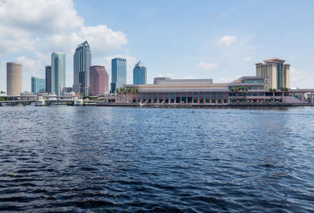 Florida skyline at Tampa with the Convention Center on the riverbank. Taken in summer during the day 스톡 콘텐츠