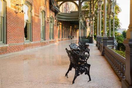 henry: Cast iron chairs on the marble patio or balcony of Henry B Plant museum is moorish inspired architecture part of the University of Tampa.