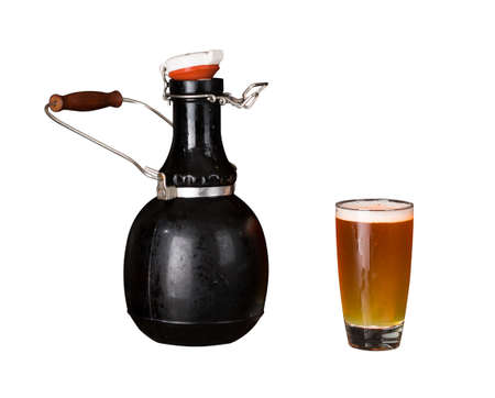 brew beer: Cutout of a large 64 fluid ounce four pint growler bottle with a glass of cold beer or ale. Used by microbreweries to serve beer for home consumption Stock Photo