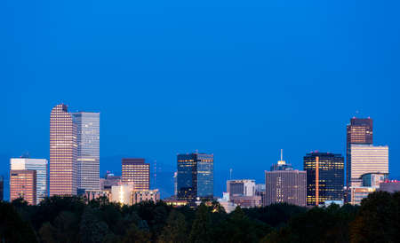 City skyline of Denver Colorado from the City Park taken from front of Science Museum just before sunrise photo