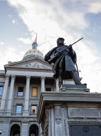 Statue of solider in front of the State Capitol Dome in Denver Colorado shortly after sunrise Editorial