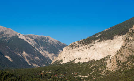 Valley of  chalk white cliffs of Mount Princeton near Buena Vista in Colorado shortly after sunrise as the sun first lights the mountainside Stock fotó