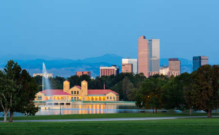City skyline of Denver Colorado from the City Park taken from front of Science Museum just before sunrise with the fountain and Boathouse and Ferril Lake