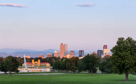 denver parks: City skyline of Denver Colorado from the City Park taken from front of Science Museum just before sunrise with the fountain and Boathouse and Ferril Lake