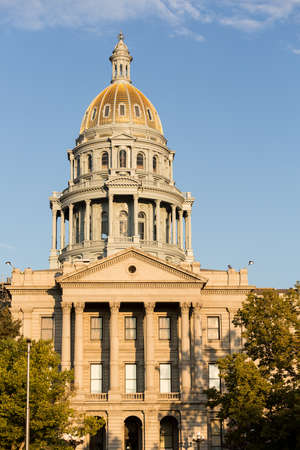 capital of colorado: The gold leaf covered dome of the State Capitol Dome in Denver Colorado shortly after sunrise